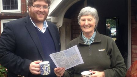Josh Tidy and Vida Browning with their collection mugs.
