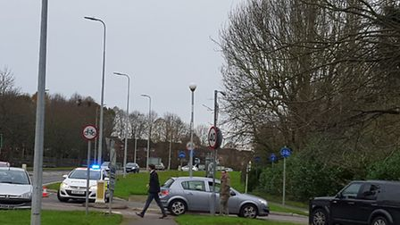 Police stopping cars from heading up Aston Lane in Stevenage after a crash involving a car and tract