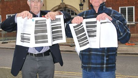 Keep Hitchin Special chairman Chris Parker and PR officer Robin Dartington with the redacted FOI on