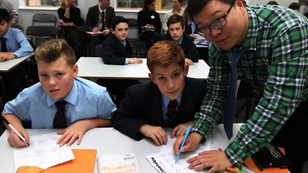 Shanghai teacher Xiaobao Wu gives Nobel students Connor Gray and Alfie Kassir a few pointers during
