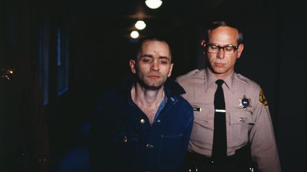 Charles Manson being led back into the courtroom to hear the penalty he and this three female follow