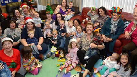Charmaine Rogers with mums and children at the centre