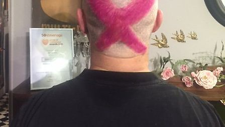 Andrew Archer has had the breast cancer logo emblazoned on his head to raise money for charity.