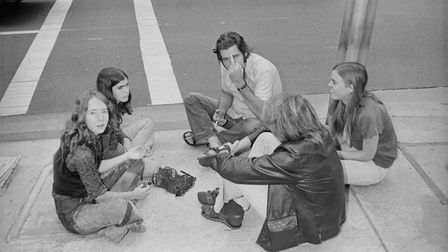 Members of the Manson Family, including Lynette Fromme and Ruth Ann Moorehouse, sitting outside the