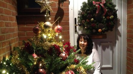 Lesley Rankin with the tree outside her dad's home in Leaden Roding