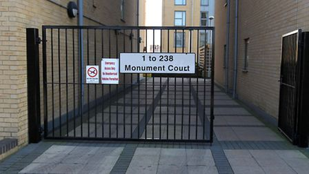 A lock has been fitted to a door at Monument Court in Stevenage to secure the flat block.