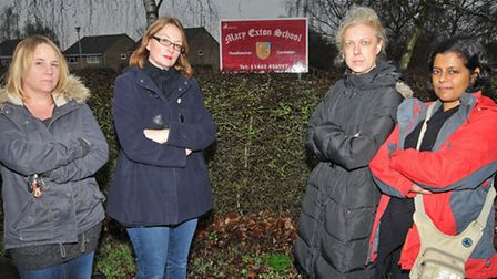 Concerned mums Becky Haylett, Sophie Root, Natasha Ennew and Devi Kroll outside Mary Exton School
