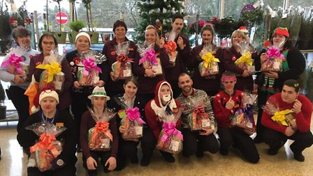 Sainsburys Coreys Mill staff with hampers they delivered to the Douglas Drive Senior Citizens Centre