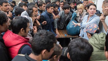 Selma Wanes, right, with migrants in Belgrade in September.