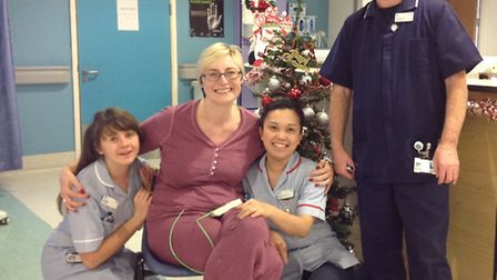 Nikki Duffy with criticial care unit staff at Queen's Hospital just over a week after she collapsed