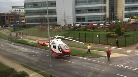 The Herts Air Ambulance lands in Six Hills Way, Stevenage, after Nikki Duffy collapsed at work. Pict