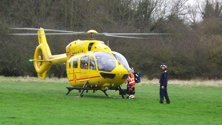 The East Anglian Air Ambulance crew after landing in grassland in the Fishers Green area of Stevenag