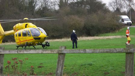 The East Anglian Air Ambulance after landing in grassland in the Fishers Green area of Stevenage. Pi