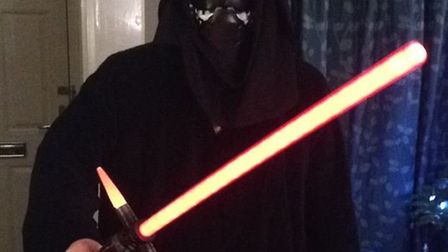 Matt Adcock from Hitchin dressed as a Stars Wars Sith ahead of the film's midnight premiere at Steve