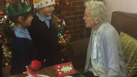 Woolenwick Infants' School in Stevenage delivered homemade Christmas cards to Tabor Court in Letchwo