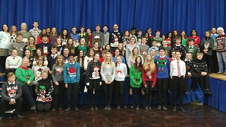 Staff and Students from Barnwell Upper School show off their Christmas jumpers to raise money for ch