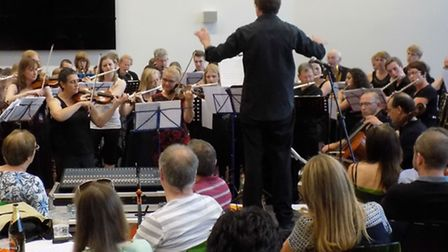 Hitchin Light Orchestra, led by conductor Chris Pyne, in concert at North Herts College's Hitchin ca