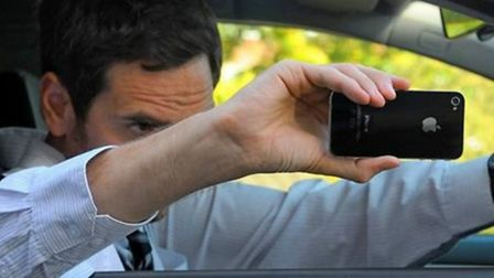 Police have been warned about taking pictures of crash scenes on their mobile phones as they wait in