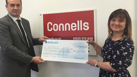 David Plumtree of Connells presents partners ball proceeds of £2,670 to community fundraising manage