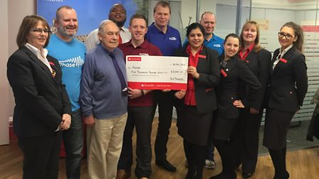Banking on your support: the giant contribution is handed over to the Phase team at the Santander br
