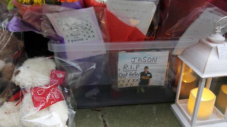 Flower tributes for a 29-year-old who died after falling from the High Plash flats on Thursday