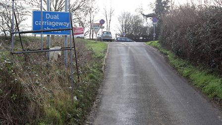 Road signs on Carters Lane, formerly Wibbly-Wobbly Lane, at the junction with the A505.