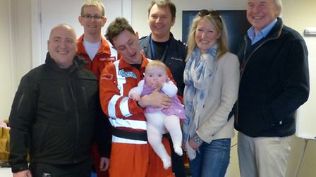 Rob and Claire Smith (right) with Milli and the ambulance crew
