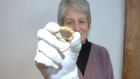 Carolyn Wingfield, of Saffron Walden Museum, with the Viking ring that was found in the Thaxted are