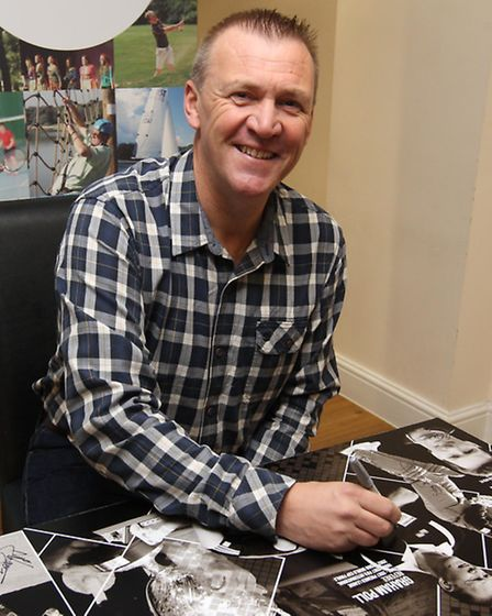 Former Premier League Referee Graham Poll from Stevenage signs a photo at Gordon Craig Theatre