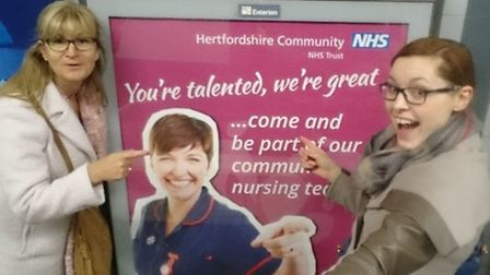 Ruth Griffin and Katie Blackburn of the Hertfordshire Community NHS Trust with one of the posters of