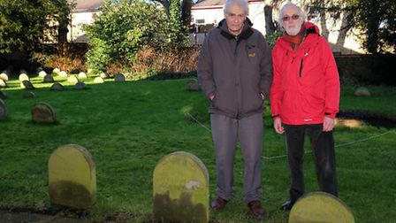 Hitchin Quakers Allan Whitaker and Bob Harrold next to the headstones of the conscientious objectors