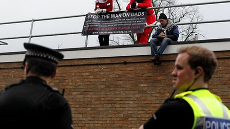 Three people have been arrested and charged after a New Fathers 4 Justice protest on the roof of Ste