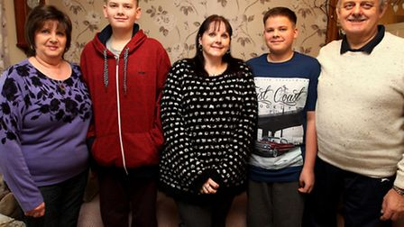 Mum Tracey Brown, pictured with her two twin 14-year-old sons Jamie and Jordan and flanked by her pa