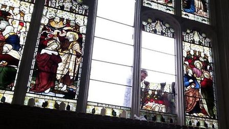 A specialist helps reinstate the stained glass windows at St Mary's Church