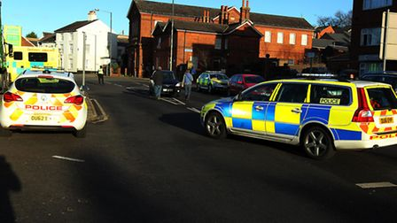 Police at the scene on Queen Street, Hitchin immediately after the collision which saw a woman in he