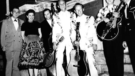 Hall Willis, Ginger Willis and Tommy Hill stand next to The Louvin Brothers outside the Ryman Audito