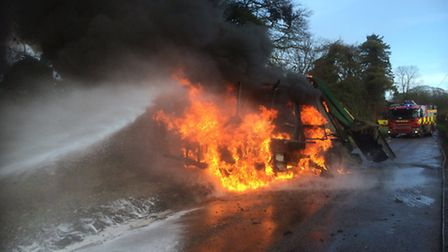 Tractor fire being extinguished. Picture: Essex Fire