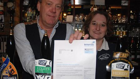 Terry Gaskin and Karen Rand with the letter from British Gas, address to Prince Charles.