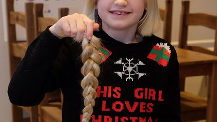 Holly Smith, 8 has her haircut to raise money for the Little Princess Trust