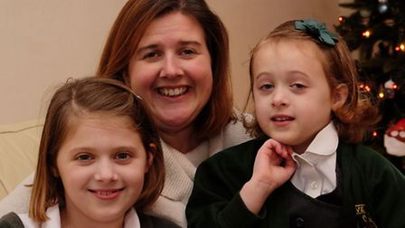 Louise Hogan with her daughters Ellie, 9 and Alex, aged six.