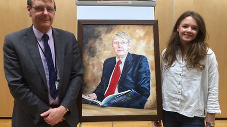 John Hartley with his painting by Emily Dan, right.