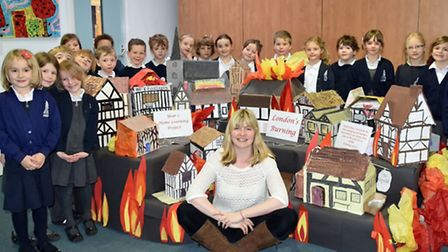 Year 2 pupils at Newport Primary School display their Great Fire of London houses with teacher Rache