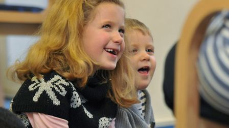 Children attend a stoytelling event at Stevenage library for libraries day