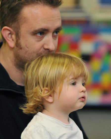 Children and their parents attend a stoytelling event at Stevenage library for libraries day