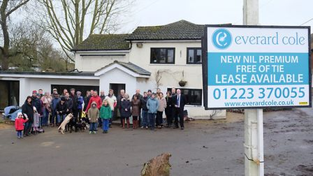 Villagers and supporters outside the former Windmill pub are making an appeal to NHDC to have a clau