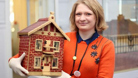 Emily Shepperson, curatorial assistant, with one of the models part of the Life in Miniature exhibit