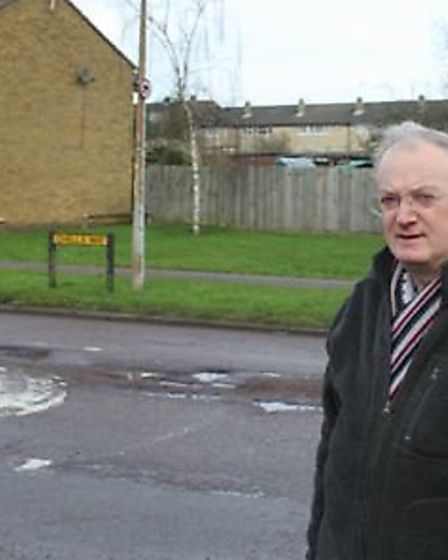 Stevenage councillor Robin Parker in Chells Way, which is littered with potholes.
