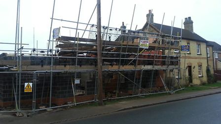 The scene after the wall collapse on Hitchin Road in Arlesey yesterday.