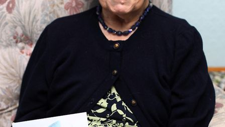 Betty Small, pictured with her birthday card from the Queen.