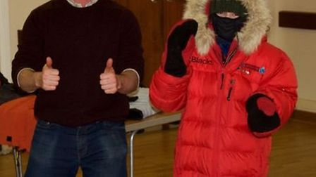 St Thomas More School Year 5 pupil Leah Grant models the latest in Arctic-wear with Antony Jinman.